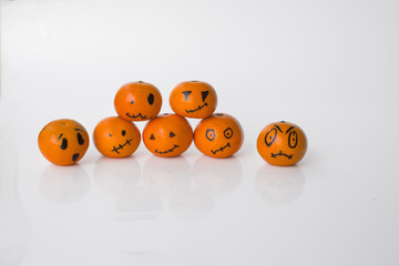Horizontally background with seven tangerines pumpkins