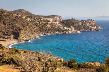 Undiscovered paradise beach with emerald waters on the way the historic city of Knidos in Datca peninsula, Mugla,Turkey.