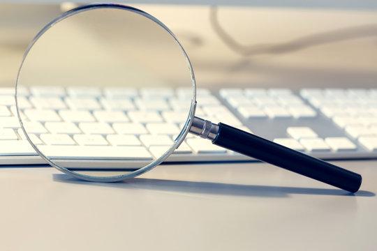 Magnifier and computer keyboard as a symbol, searching, checking, monitoring virtual reality.