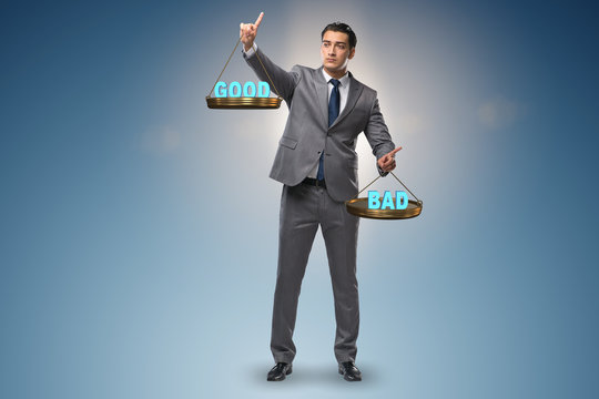 Businessman choosing between good and bad