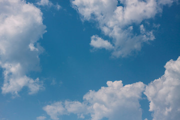 White textured clouds on blue sky background