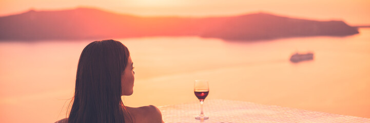 Wall Mural - Luxury travel woman drinking red wine glass watching sunset on cruise ship holiday vacation - rich people high end lifestyle banner panorama landscape.