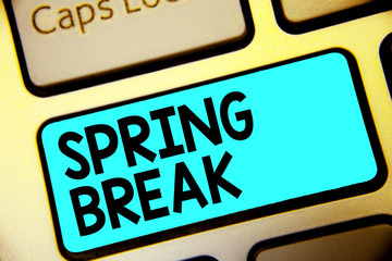 Writing note showing Spring Break. Business photo showcasing Vacation period at school and universities during spring Keyboard blue key Intention computer computing reflection document