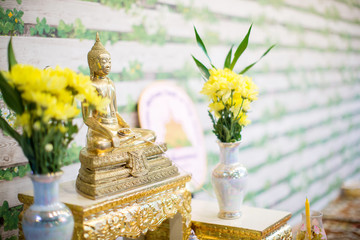 set of altar table in wedding hall. stage for place the buddha statue for pray and worship before begin the Buddha ceremony. image for background, objects and copy space.
