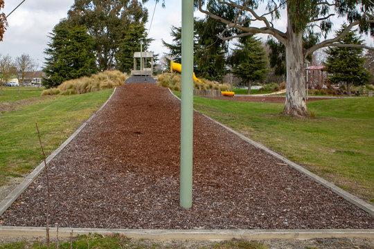 Bark chip mulch under a flying fox in a children's playground