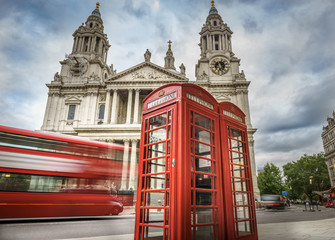 Canvas Prints London red bus red phone boxes and red bus passing Saint Paul's Cathedral in London at cloudy day