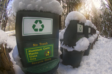 Snow covered recycling bins support ecotourism in Yosemite National Park.