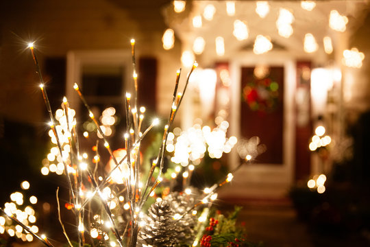 shining Christmas decorations outside the house. beautiful glowing Christmas composition of fir branches and cones outside