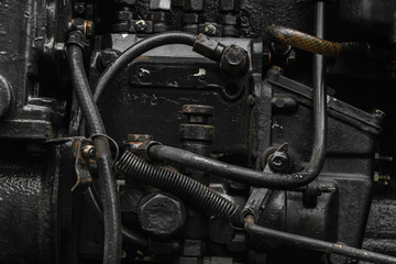 Background surface of old, black and oily machine engine