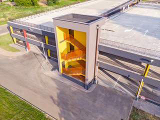 drone photo of modern empty multilevel car parking with emergency exit stairs