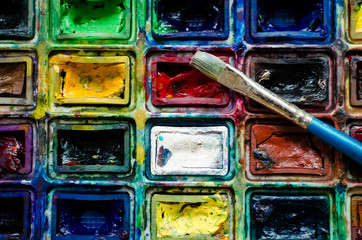 Artist paint brush and watercolor paintbox