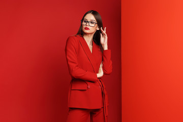 Wall Mural - Fashion young woman in red suit.