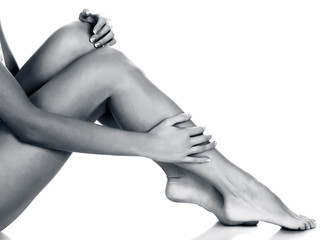 Woman's legs on white background, isolated