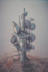 Communication tower with many antenna the mountains, looks like extraterrestrial environment