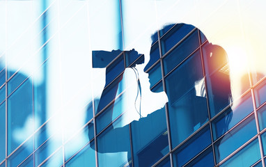 Businessman looks for new job opportunities with binoculars. double exposure