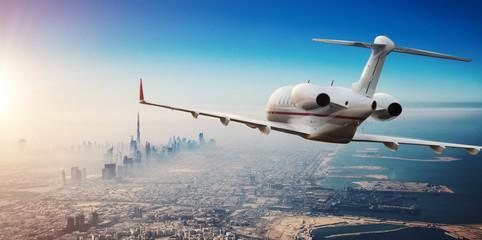 Luxury private jetliner flying above Dubai city, UAE. Wall mural