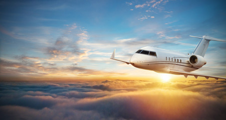 Luxury private jetliner flying above clouds