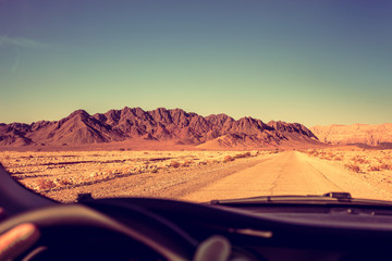 Driving a car on the road in the desert. The road to Timna Park near Eilat, Israel
