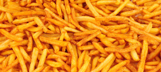 Crispy golden French fries background Wall mural