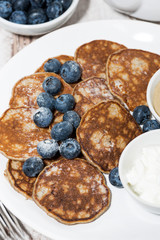 homemade pancakes with peanut butter and yoghurt, vertical closeup