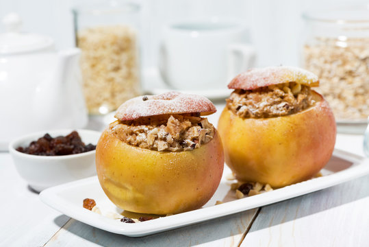 healthy breakfast. portioned oatmeal with raisins baked in apple