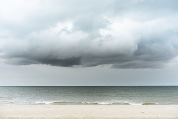 the half dark and bright weather on the beach.