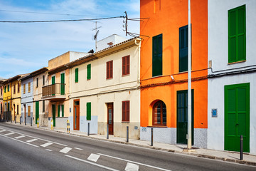 Street in Alcudia with colorful building facades, Mallorca, Spain.
