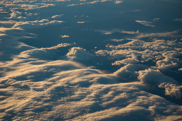 Sunset or sunlight above cloud view from airplane window. Beautiful view like heaven.