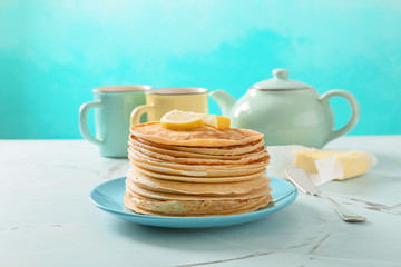 Stack of delicious thin pancakes on plate