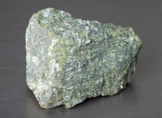Specimen of mineral asbestos on gray background