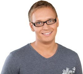 Portrait photograph of a caucasian man in glasses smiling