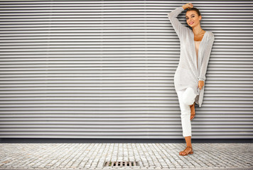 slim young woman and wall background