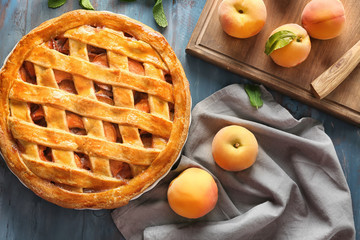 Delicious peach pie on wooden table