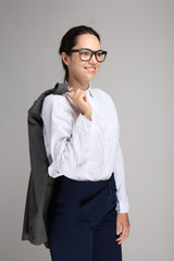 Beautiful businesswoman on grey background