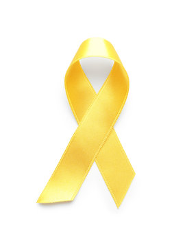 Yellow ribbon on white background. Cancer awareness concept