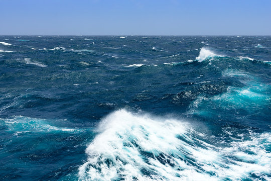 Big waves at open sea. Summer monsoon in Indian Ocean