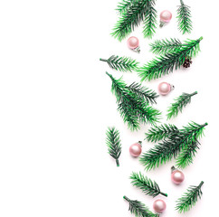 Christmas composition with fir branches and balls on white background