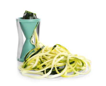 Fresh zucchini spaghetti with spiral grater isolated on white