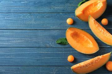 Tasty cut melon on wooden table