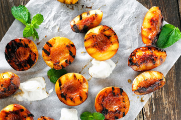Honey grilled peaches served mint ice cream top view Wall mural