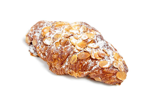 Croissant with almonds isolated on white background