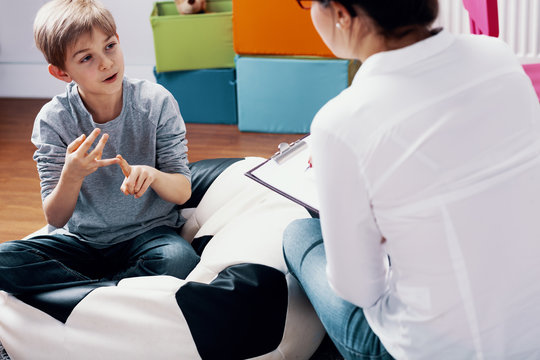 Child talking with teacher during extracurricular classes at home