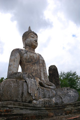 Ancient statues and buildings in sukhothai historical park, Thailand