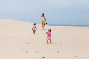 A family walks on the beach in Cape St Francis, South Africa.