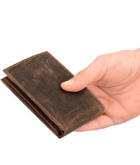 View of brown leather wallet holding in a hand with featuring slip pockets, multiple card slots and an ID card window.