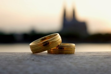 Wedding rings by the Rhine Cologne cathedral in the background