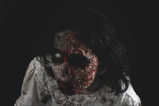 Eerie zombie woman with missing one eye