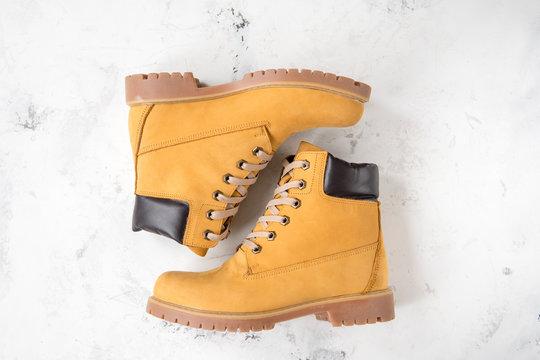 Women's winter boots. Yellow warm boots for trekking