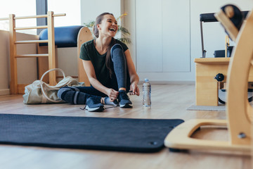 Woman at a pilates gym getting ready to leave