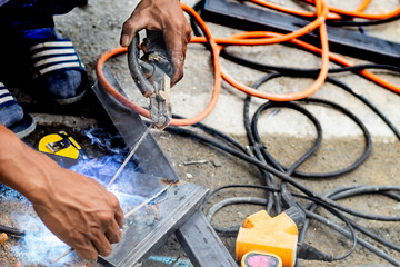 The workers are welding steel in Thailand.